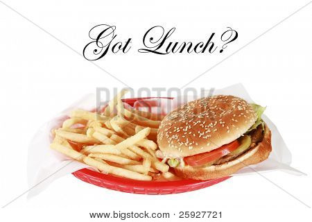 a delicious cheese burger and french fries in a red plastic burger basket isolated on white with room for your text