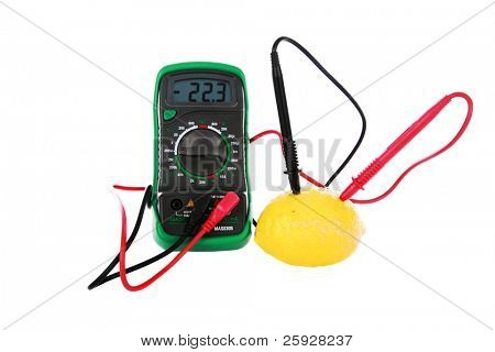 "A ""lemon battery"" isolated on white with room for your text. A multimeter with positive and negative electrodes inserted into a lemon measures the ""bio electrical current"" created a fresh picked lemon"