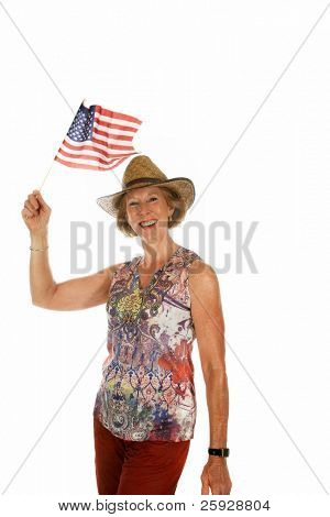 a beautiful woman waves her american flag with pride on the forth of july or Independence day or flag day or veterans day or any day she likes. isolated on white with room for your text