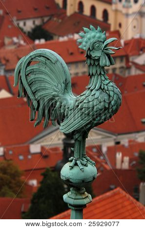 Bronze weathercock at the roof of St Vitus' Cathedral at Prague Castle, Czech Republic