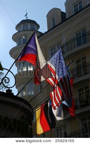 Welcome! American, Czech, Israeli and German flags on a hotel in Karlovy Vary, Czech Republic.