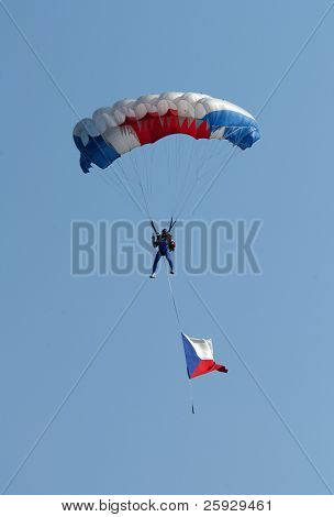 Parachutist jumping with the Czech national flag