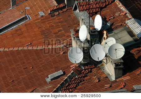Six dish antennas on the tiled rooftop in Galata district in Istanbul, Turkey