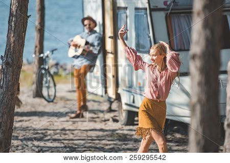 Young Hippie Woman Dancing While