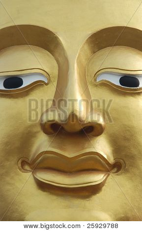 Gilded face of Buddha at Buddha Hill in Pattaya, Thailand