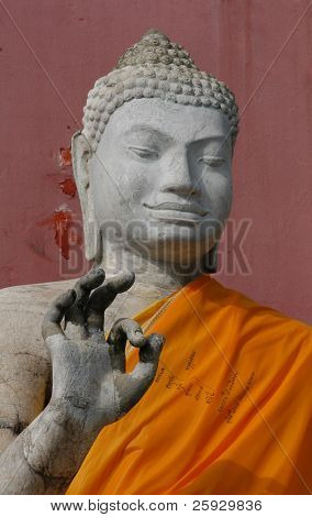 Stone Buddha making OK sign from the temple of Nakhon Pathom, Thailand
