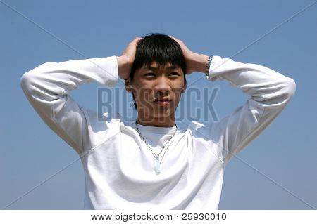 Worried young Asian man holding a head