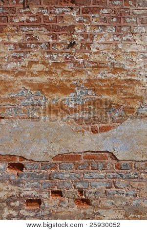 Old brick wall of a barrack of a nazi police prison in Terezin, Czech Republic
