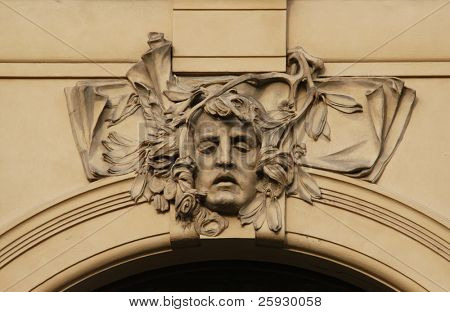 Allegory of poetry, a stucco mask on the facade of the Municipal House in Prague, Czech Republic