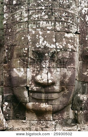 Huge stone face of Bodhisattva Lokesvara form Bayon Temple in the Angkor Area near Siem Reap, Cambodia.