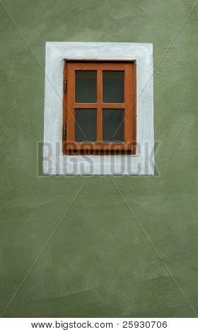 Small window on the green wall in Cesky Krumlov, Czech Republic.
