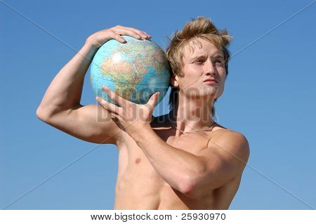 Young muscular man holding a globe