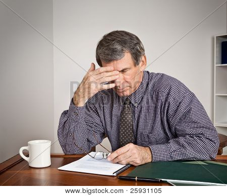 Overworked, Tired Businessman At Desk