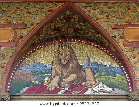 Czech two-tailed Lion, the Czech national emblem, in the mosaic from 19th century on a bank building in Prague, Czech Republic.