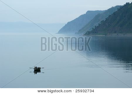 Fishermen rowing their boat in Lake Baikal in Siberia, Russia