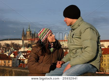 Loving couple with Prague Castle behind in Prague, Czech Republic