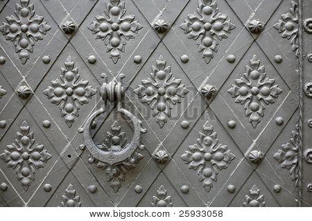 Old pattern gate with a knocker in Konopiste Chateau near Prague, Czech Republic