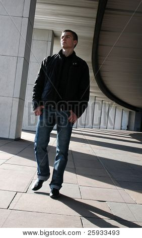 Young man walking on the colonnade