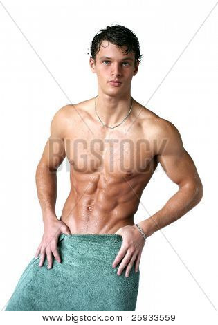 Wet muscular sexy man wrapped in a towel isolated on white