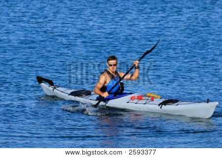 Atheltic Man Kayaking In Mission Bay