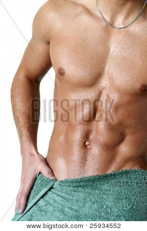 Wet muscular torso wrapped in the towel isolated on white