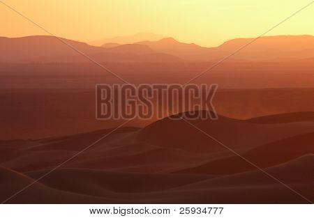 Sunset over the sand dunes of Erg Chebbi in the Sahara Desert near Merzouga, Morocco.
