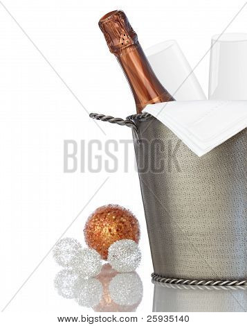 Elegant Champagne And Crystal Glass Flutes Chilling In Texured Hammered Metal Wine Bucket With Bronz
