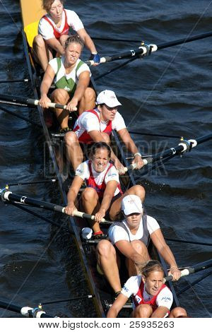 PRAGUE - June 6: Female rowing team rowing ahead during a boat-race in Prague, Czech Republic, on June 6, 2009