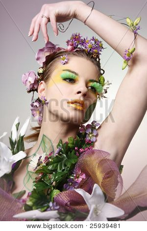 Young beautiful woman in pink and white flowers.