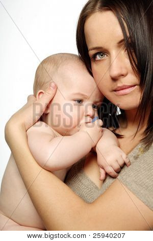 Young attractive mother with cute child.