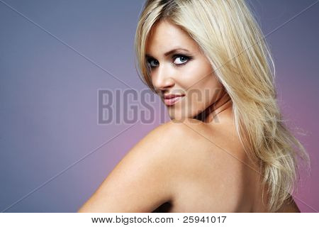 Beautiful young happy blond woman with long hair.