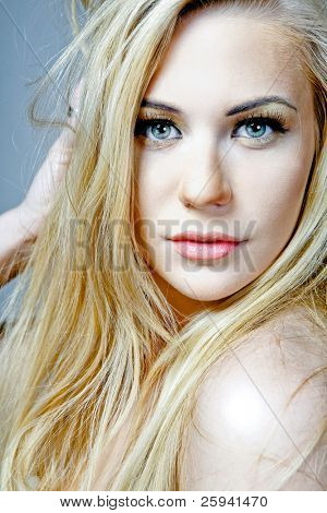 Young attractive female model with long blond hair.