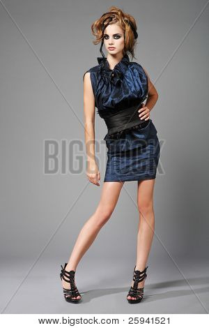 High fashion portrait of young, slim, beautiful model.