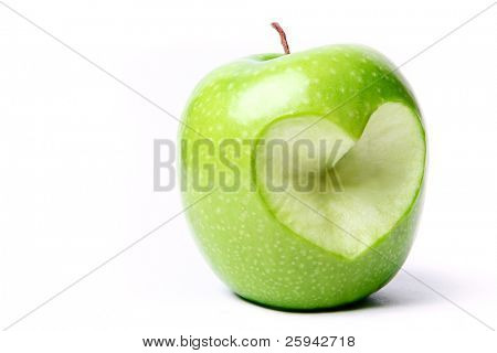 Green apple with cut off heart shape.