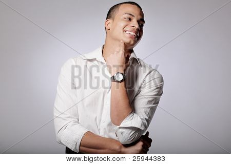 Young African-American male fashion model posing in studio.