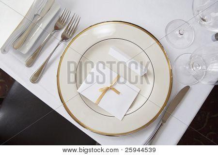 Elegant table set at fine restaurant. Wedding reception.