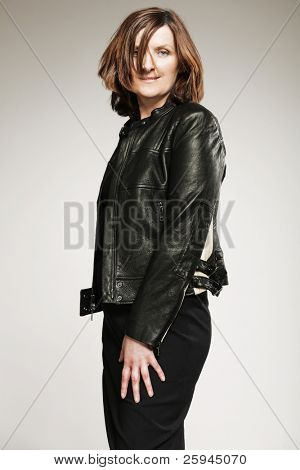 Attractive happy middle-aged woman in black jacket.