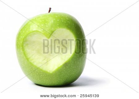 Fresh green apple with cut off heart shape.