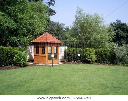 Gazebo in the garden with two lamps