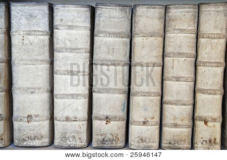 Detail of ancient book backbones - tomes about medicine in latin