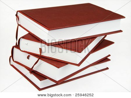 Stack of four same books with brown cover isolated on white
