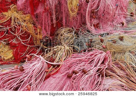 Large heap of colorful fishing nets - good for background