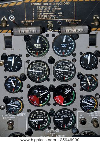 Detail of a small airplane cockpit with various indicators and buttons