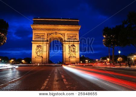 Beautifully lit Triumph Arch at night with light traces of passing cars. Paris, France.