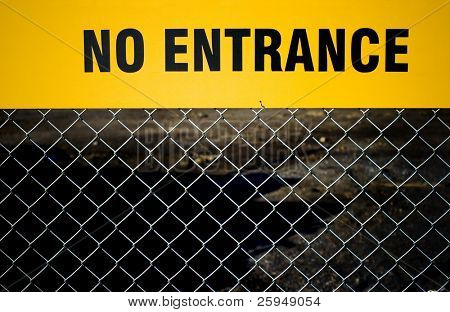 """No Entrance"" sign on a fence."