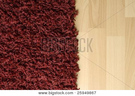 Red fluffy rug on laminate floor