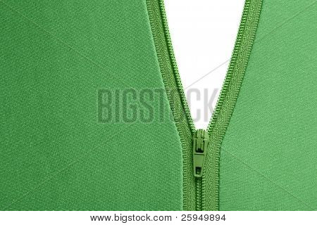 Zipper of a green garment revealing a white surface