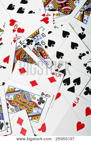 new, un-used playing cards in a random arrangement