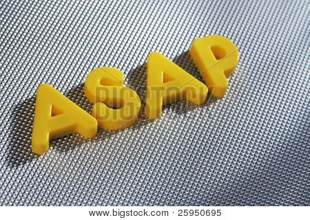 Word ASAP (acronym for As Soon As Possible) written with yellow plastic letters