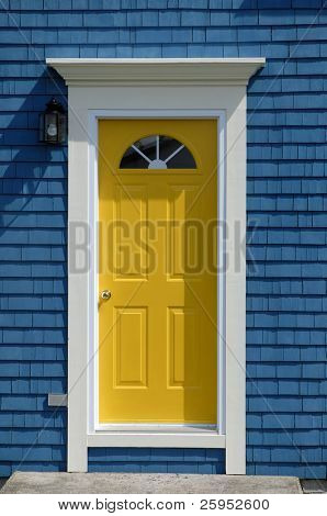 A Bright Yellow Front Door On An Old Traditional Cedar Shake House